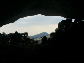 Waiting out a rain storm in our cave while sipping whiskey and reading the guidebook. Photo: Nick Sweeney